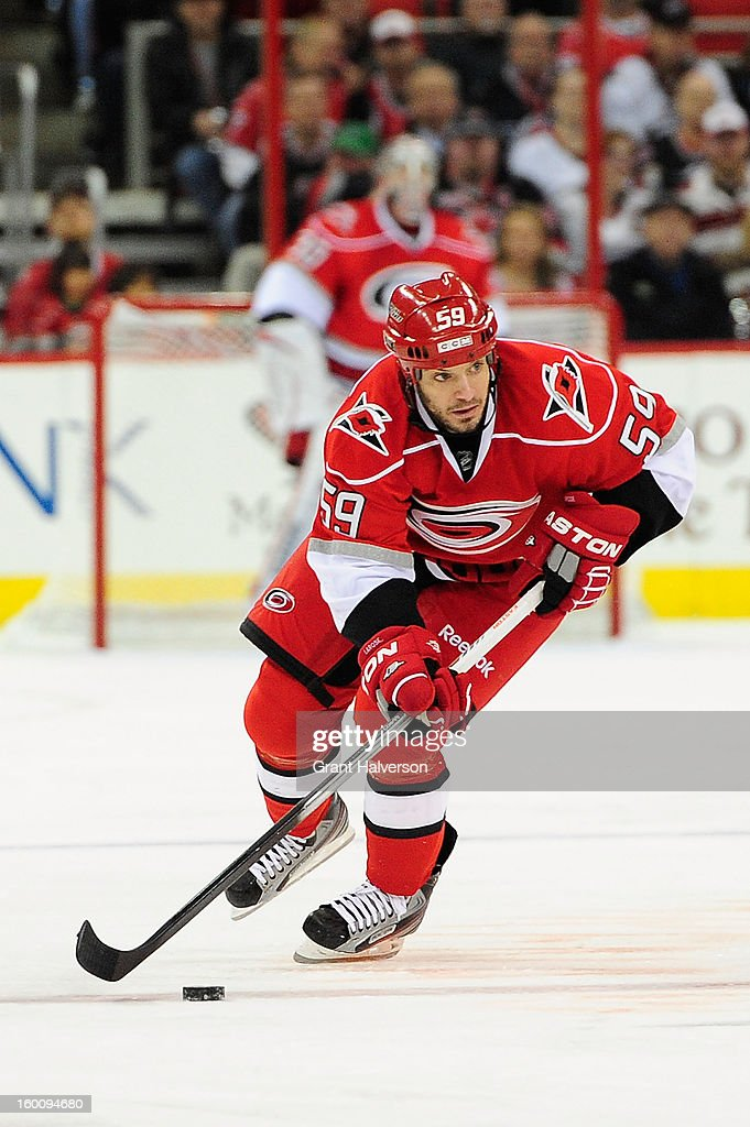 Chad LaRose #59 of the Carolina Hurricanes against the Buffalo Sabres during play at PNC Arena on January 24, 2013 in Raleigh, North Carolina. Carolina defeated Buffalo, 6-3.