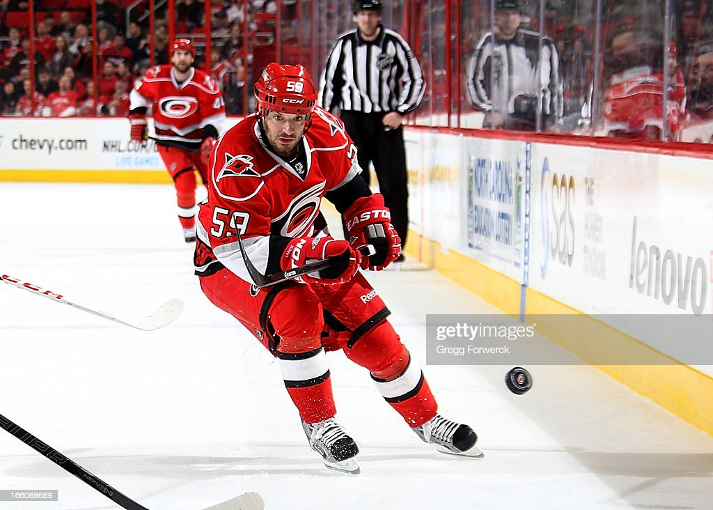 <a gi-track='captionPersonalityLinkClicked' href=/galleries/search?phrase=Chad+LaRose&family=editorial&specificpeople=546026 ng-click='$event.stopPropagation()'>Chad LaRose</a> #59 of the Carolina Hurricanes chases a loose puck against the Washington Capitals during their NHL game at PNC Arena on April 2, 2013 in Raleigh, North Carolina.