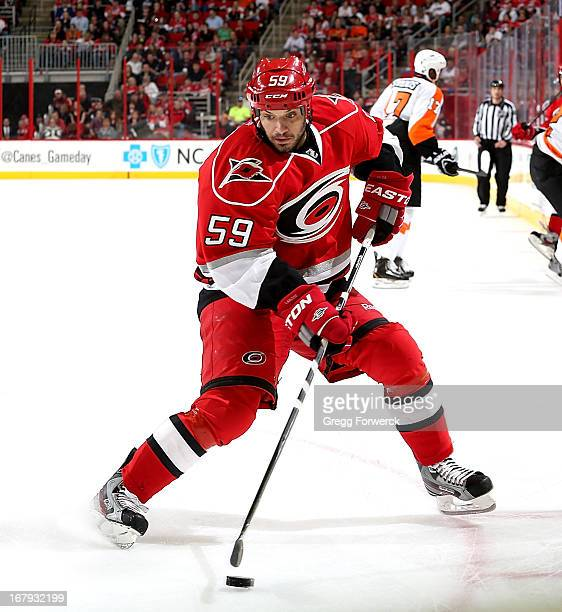 Chad LaRose of the Carolina Hurricanes controls the puck on the ice against the Philadelphia Flyers during their NHL game at PNC Arena on April 20...