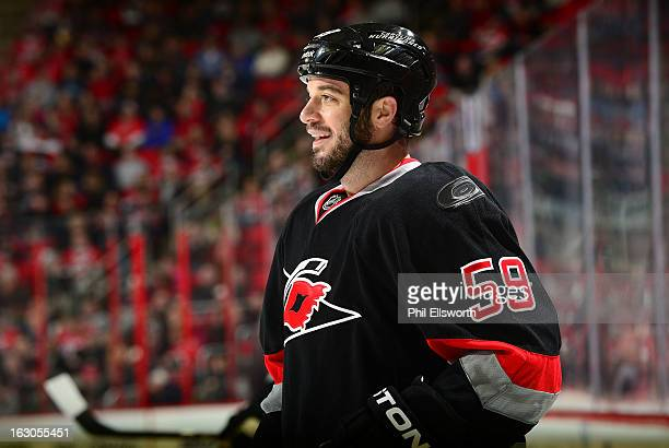 Chad LaRose of the Carolina Hurricanes cracks a smile during an NHL game against the Tampa Bay Lightning on February 23 2013 at PNC Arena in Raleigh...