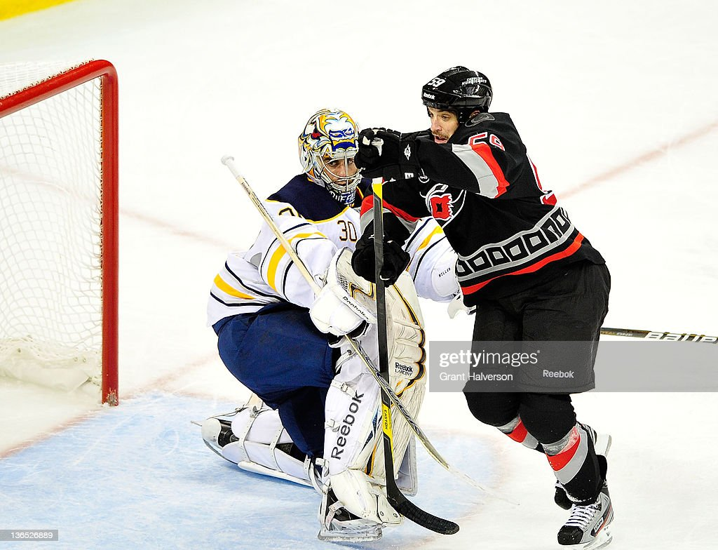 <a gi-track='captionPersonalityLinkClicked' href=/galleries/search?phrase=Chad+LaRose&family=editorial&specificpeople=546026 ng-click='$event.stopPropagation()'>Chad LaRose</a> #59 of the Carolina Hurricanes crashes into goalkeeper Ryan Miller #30 of the Buffalo Sabres as he drives to the net during play at the RBC Center on January 6, 2012 in Raleigh, North Carolina. The Hurricanes won 4-2.
