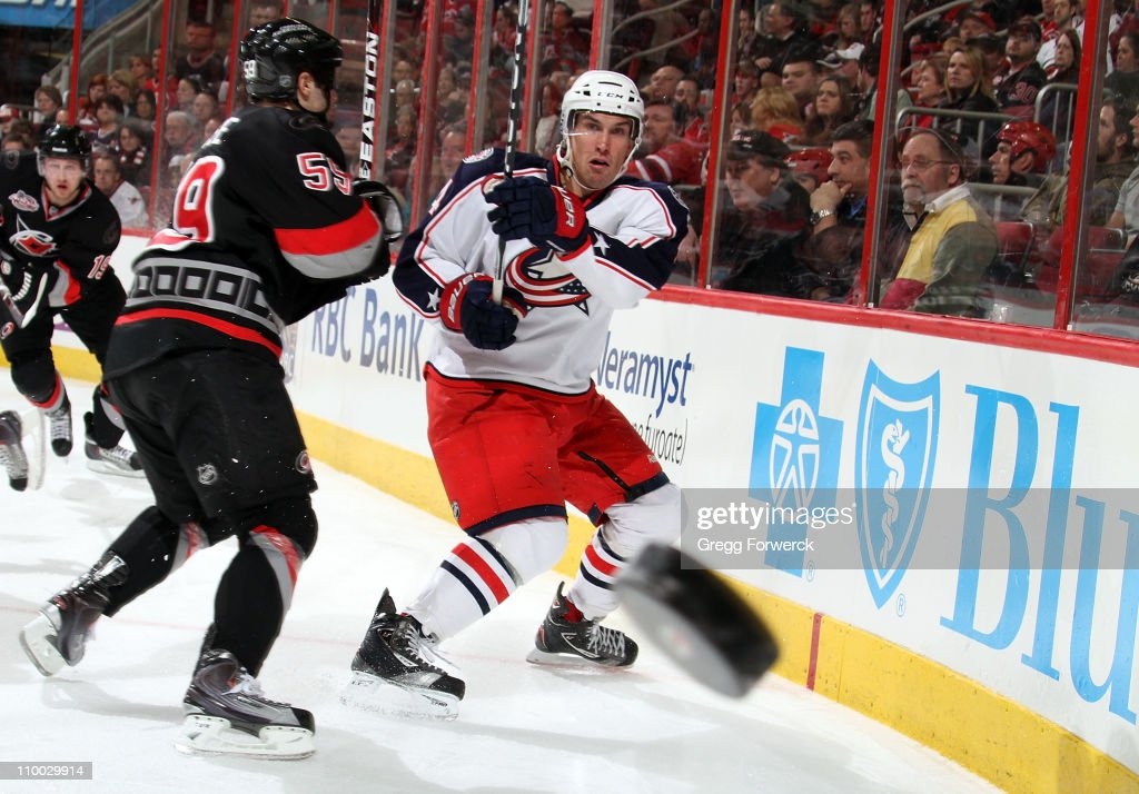 <a gi-track='captionPersonalityLinkClicked' href=/galleries/search?phrase=Chad+LaRose&family=editorial&specificpeople=546026 ng-click='$event.stopPropagation()'>Chad LaRose</a> #59 of the Carolina Hurricanes defends <a gi-track='captionPersonalityLinkClicked' href=/galleries/search?phrase=Sami+Lepisto&family=editorial&specificpeople=2533741 ng-click='$event.stopPropagation()'>Sami Lepisto</a> #4 of the Columbus Blue Jackets as he shoots the puck during an NHL game on March 12, 2011 at RBC Center in Raleigh, North Carolina.