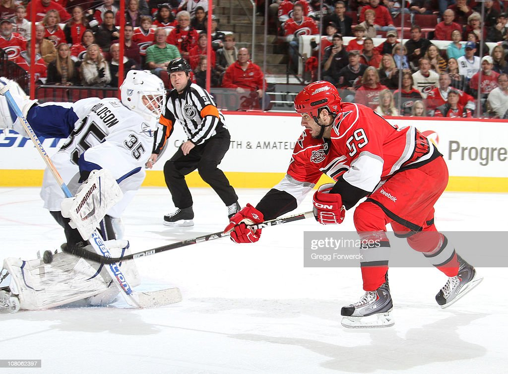 <a gi-track='captionPersonalityLinkClicked' href=/galleries/search?phrase=Chad+LaRose&family=editorial&specificpeople=546026 ng-click='$event.stopPropagation()'>Chad LaRose</a> #59 of the Carolina Hurricanes gets a breakaway and lifts the puck past <a gi-track='captionPersonalityLinkClicked' href=/galleries/search?phrase=Dwayne+Roloson&family=editorial&specificpeople=202970 ng-click='$event.stopPropagation()'>Dwayne Roloson</a> #35 of the Tampa Bay Lightning during a NHL game on January 15, 2011 at RBC Center in Raleigh, North Carolina.