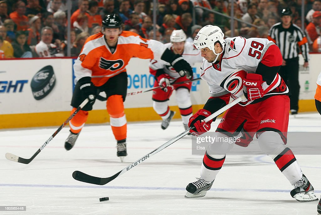<a gi-track='captionPersonalityLinkClicked' href=/galleries/search?phrase=Chad+LaRose&family=editorial&specificpeople=546026 ng-click='$event.stopPropagation()'>Chad LaRose</a> #59 of the Carolina Hurricanes heads for the net as <a gi-track='captionPersonalityLinkClicked' href=/galleries/search?phrase=Sean+Couturier&family=editorial&specificpeople=5663953 ng-click='$event.stopPropagation()'>Sean Couturier</a> #14 of the Philadelphia Flyers defends on February 2, 2013 at the Wells Fargo Center in Philadelphia, Pennsylvania.