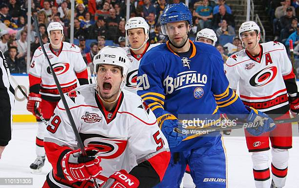 Chad LaRose of the Carolina Hurricanes heads to the bench to celebrate a first period goal with teammates along the bench as Rob Niedermayer of the...