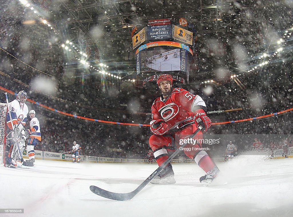 <a gi-track='captionPersonalityLinkClicked' href=/galleries/search?phrase=Chad+LaRose&family=editorial&specificpeople=546026 ng-click='$event.stopPropagation()'>Chad LaRose</a> #59 of the Carolina Hurricanes looks to play a puck along the boards in the offensive zone of the during their NHL game against the NEw York Islanders at PNC Arena on April 23, 2013 in Raleigh, North Carolina.