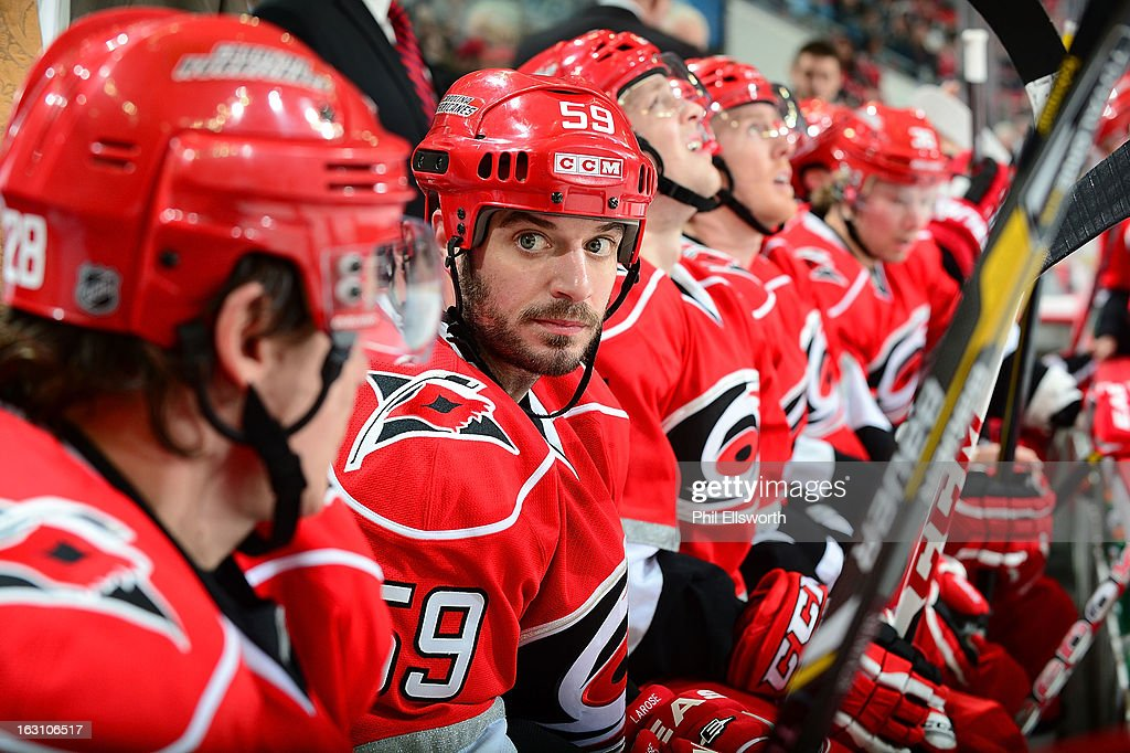 Chad LaRose of the Carolina Hurricanes rests on the bench during an NHL game against the Pittsburgh Penguins on February 28, 2013 at PNC Arena in Raleigh, North Carolina.