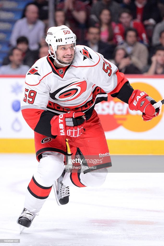 <a gi-track='captionPersonalityLinkClicked' href=/galleries/search?phrase=Chad+LaRose&family=editorial&specificpeople=546026 ng-click='$event.stopPropagation()'>Chad LaRose</a> #59 of the Carolina Hurricanes skates during the NHL game against the Montreal Canadiens at the Bell Centre on February 18, 2013 in Montreal, Quebec, Canada. The Canadiens defeated the Hurricanes 3-0.