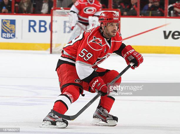 Chad LaRose of the Carolina Hurricanes skates for position on the ice against the Winnipeg Jets during an NHL game on January 23 2012 at RBC Center...