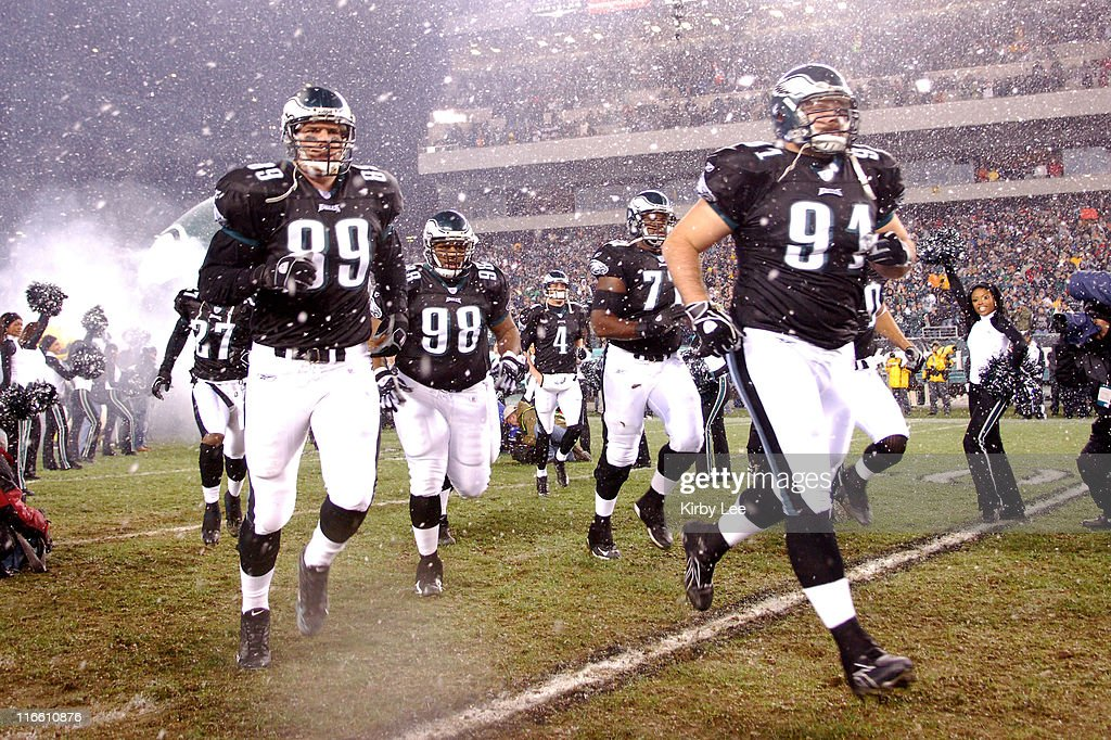 Chad Lewis Mike Patterson and Sam Rayburn run onto the field during player introductions before Monday Night Football game against the Seattle...