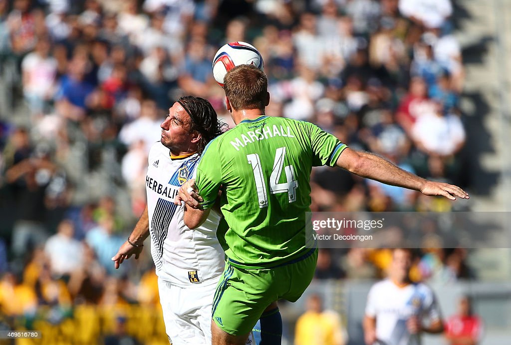 Chad Marshall #14 of Seattle Sounders wins a high ball against Alan Gordon #9 of the Los Angeles Galaxy in the first half of the MLS match at StubHub Center on April 12, 2015 in Los Angeles, California.