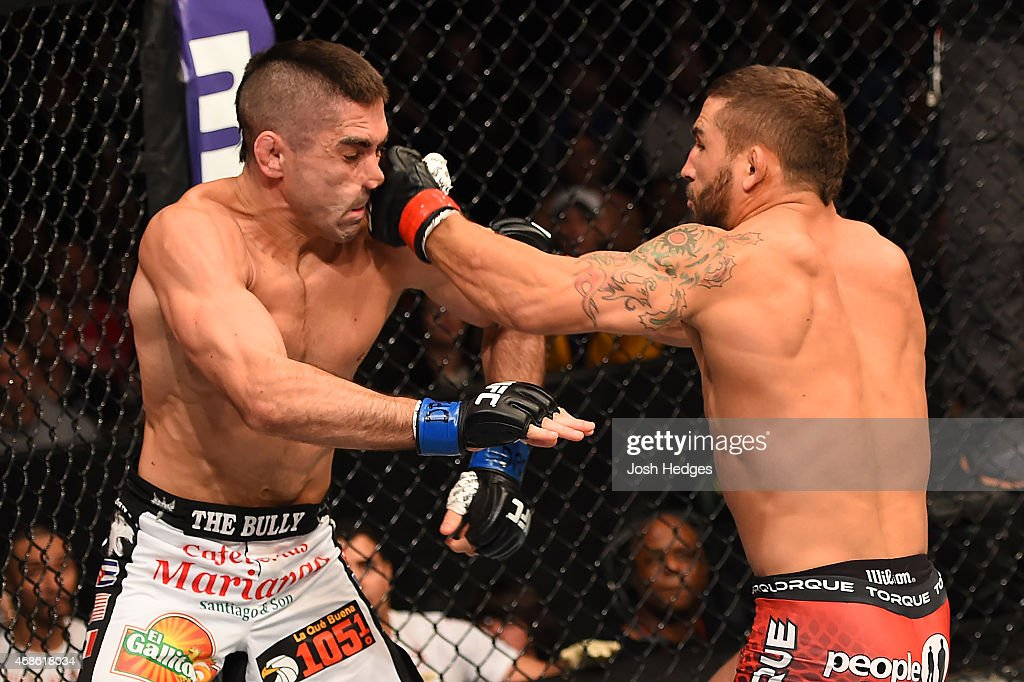 Chad Mendes punches Ricardo Lamas in their featherweight fight during the UFC Fight Night event at the Patriot Center on April 4, 2015 in Fairfax, Virginia.