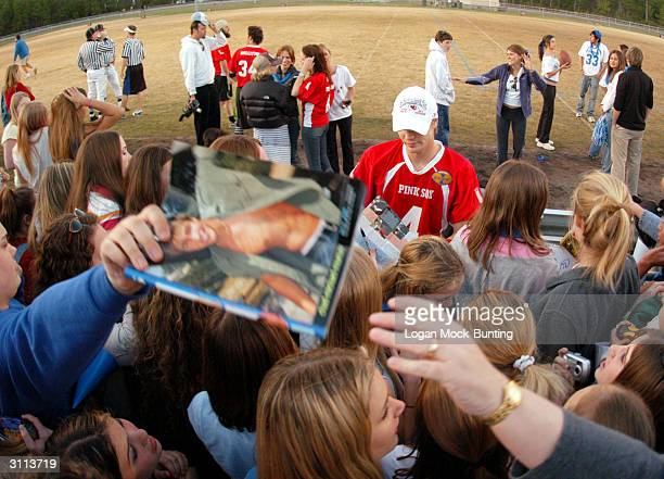 Chad Michael Murray star of 'One Tree Hill' signs memorabilia for fans during halftime of the charity football game on March 19 2004 in Wilmington...