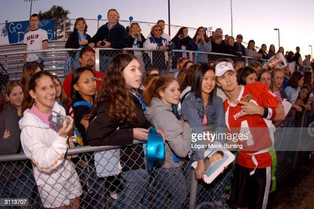 Chad Michael Murray star of 'One Tree Hill' takes photos with fans during halftime of the charity football game on March 19 2004 in Wilmington North...
