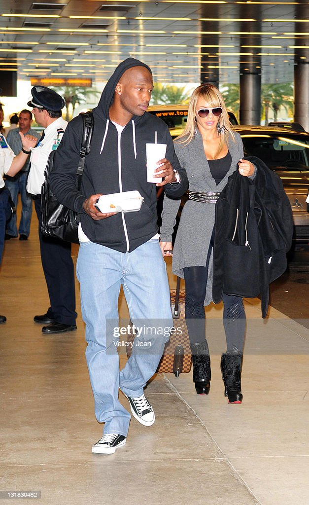 Chad Ochocinco and fiance Evelyn Lozada sighting at Miami International Airport on January 5, 2011 in Miami, Florida.