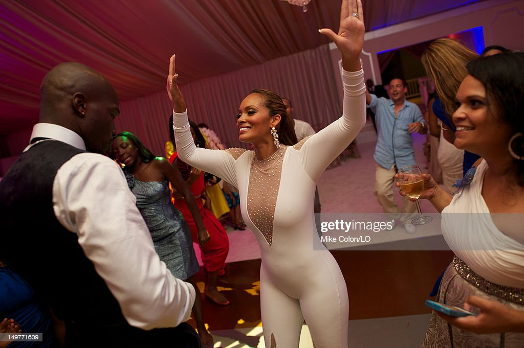 Chad Ochocinco dances during the reception for his wedding to Evelyn Lozada at Le Chateau des Palmiers on July 4, 2012 in St. Maarten, Netherlands Antillies.