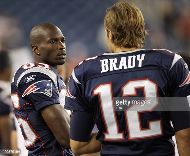 Chad Ochocinco of the New England Patriots talks with teammate Tom Brady in the fourth quarter against the Jacksonville Jaguars on August 11 2011 at...