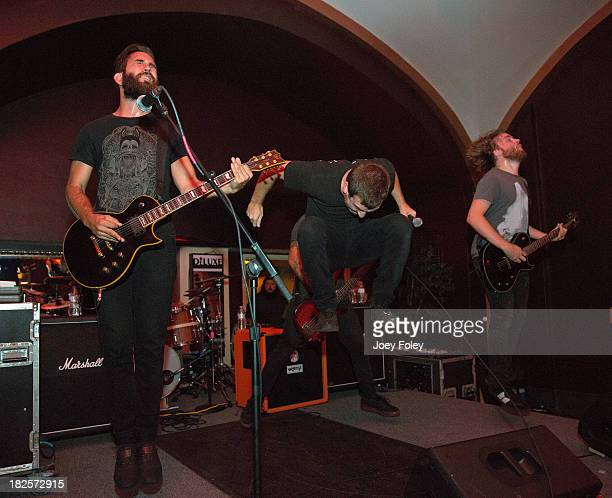 Chad Orange Luke Borza and Zack Fitzpatrick of the band Honour Crest performs live onstage at Old National Centre on September 21 2013 in...