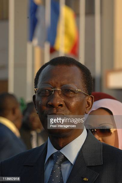Chad President Idriss Deby Itno welcomes French President Nicolas Sarkozy and wife Carla BruniSarkozy at N'Djamena Airport Chad on February 27...