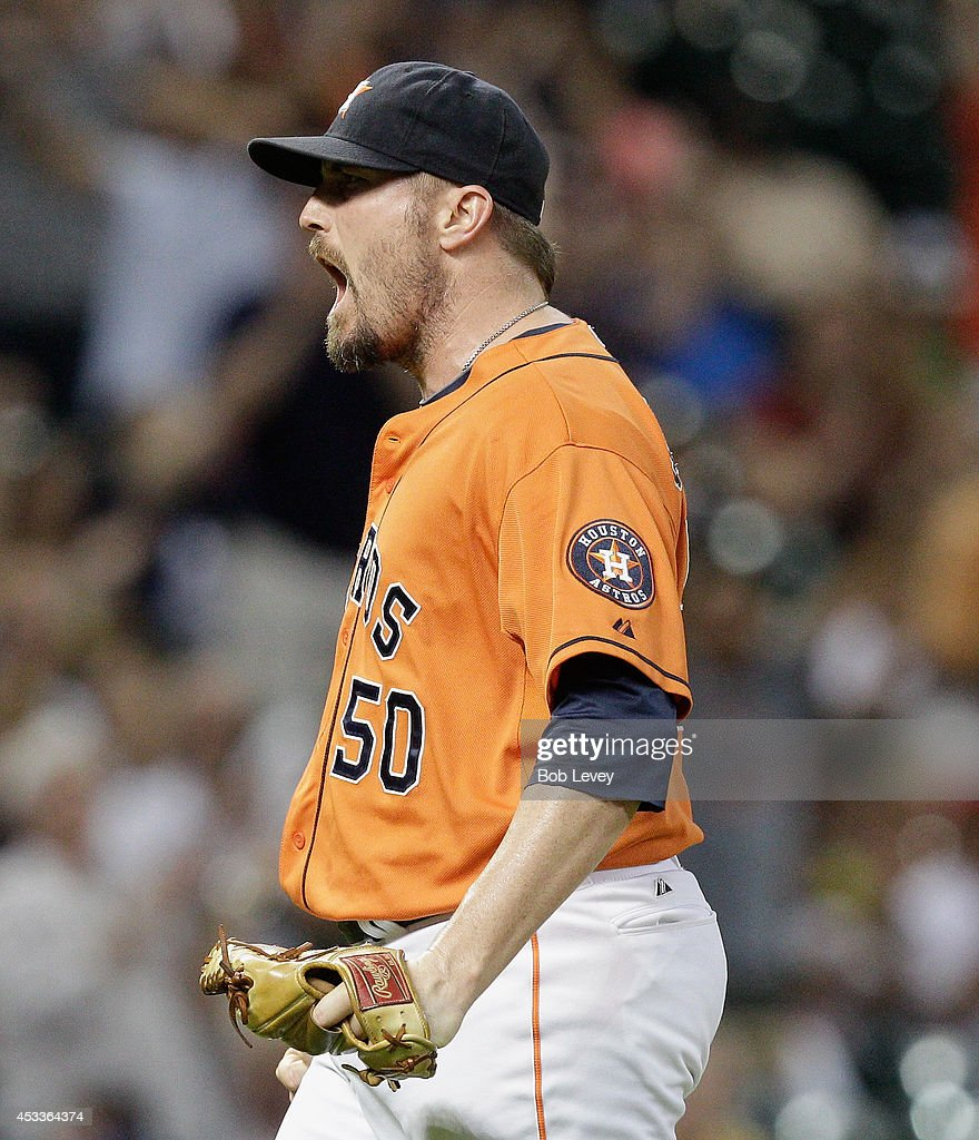 <a gi-track='captionPersonalityLinkClicked' href=/galleries/search?phrase=Chad+Qualls&family=editorial&specificpeople=588432 ng-click='$event.stopPropagation()'>Chad Qualls</a> #50 of the Houston Astros lets out yell after the final out against the Texas Rangers at Minute Maid Park on August 8, 2014 in Houston, Texas. Houston won 4-3.