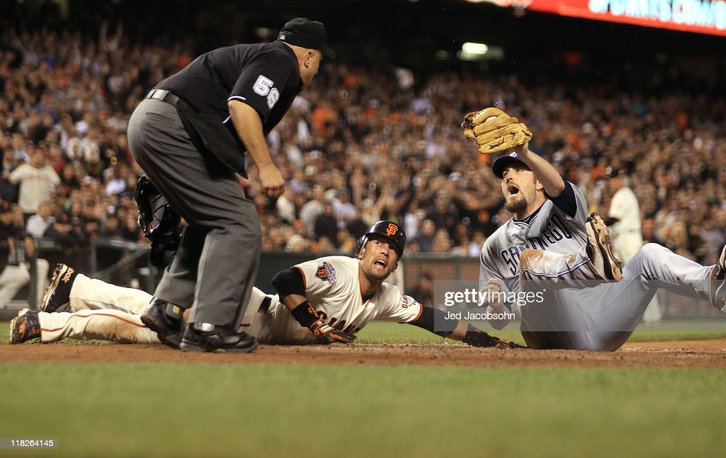 Chad Qualls of the San Diego Padres reacts after tagging out Andres Torres of the San Francisco Giants after trying to score on a fielders choice in...