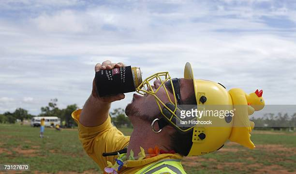 Chad Rosenblatt of the team 'Outcasts' wears a punishment helmet after he got out for a duck but is still able to drink a beer during the Goldfield...