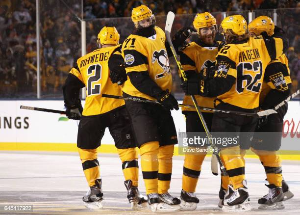 Chad Ruhwedel Evgeni Malkin Ian Cole Carl Hagelin and Phil Kessel of the Pittsburgh Penguins celebrate Ruhwedel's goal during the third period of the...