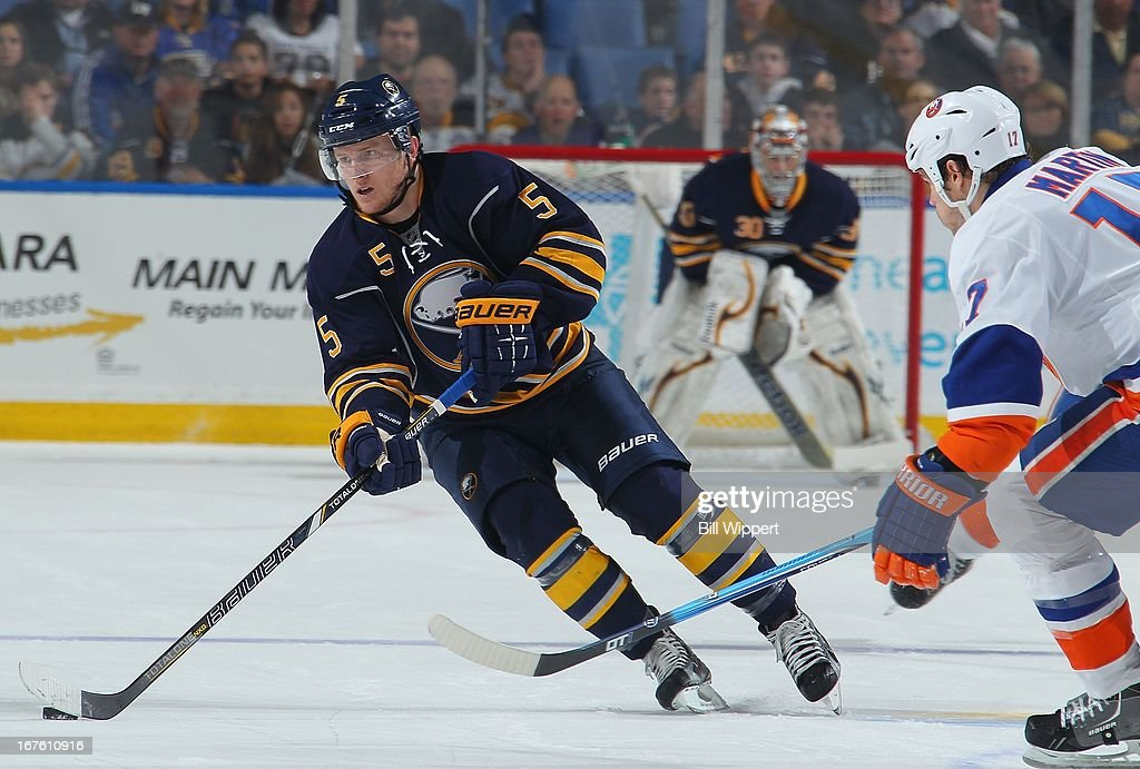 Chad Ruhwedel #5 of the Buffalo Sabres controls the puck against the New York Islanders on April 26, 2013 at the First Niagara Center in Buffalo, New York.