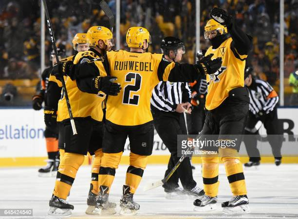 Chad Ruhwedel of the Pittsburgh Penguins celebrates his goal with Evgeni Malkin Ian Cole and Phil Kessel of the Pittsburgh Penguins during the third...