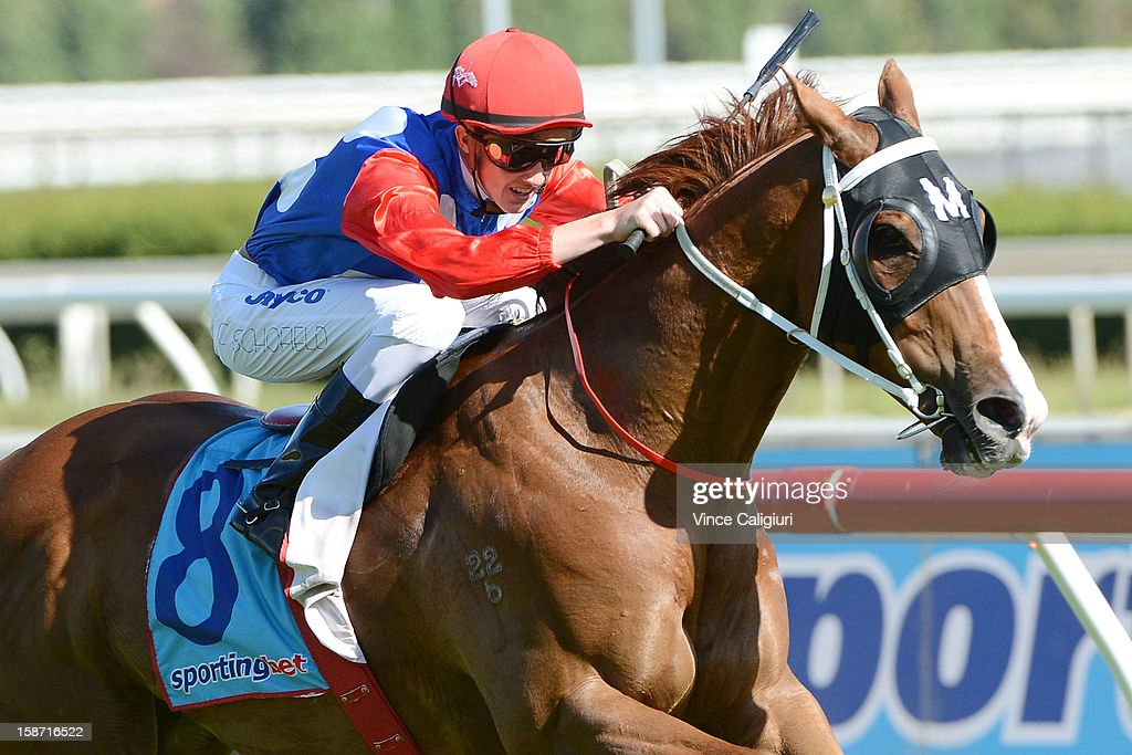 Chad Schofield riding Finishing Card wins the Swettenham Stud Summer Championship Heat 1 at Caulfield Racecourse on December 26, 2012 in Melbourne, Australia.