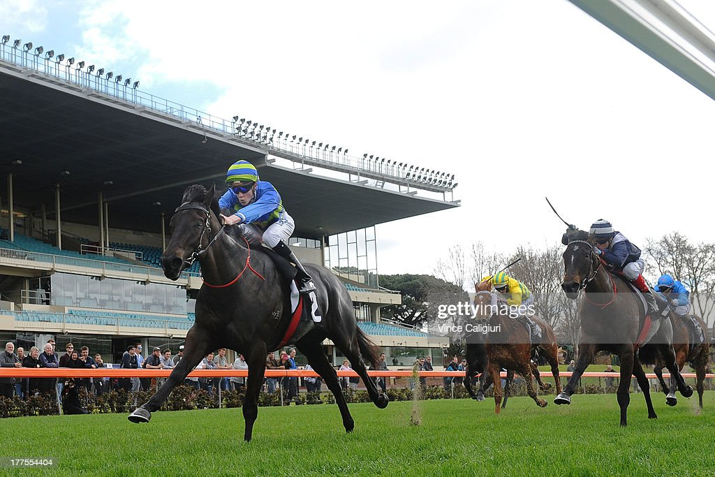Chad Schofield riding Gregers wins Mitchelton Wines Plate during Melbourne Racing at Moonee Valley Racecourse on August 24, 2013 in Melbourne, Australia.