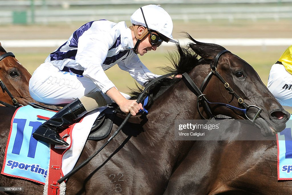 Chad Schofield riding Hidden Message wins the Late Starter Membership Handicap during Melbourne racing at Moonee Valley Racecourse on December 29, 2012 in Melbourne, Australia.