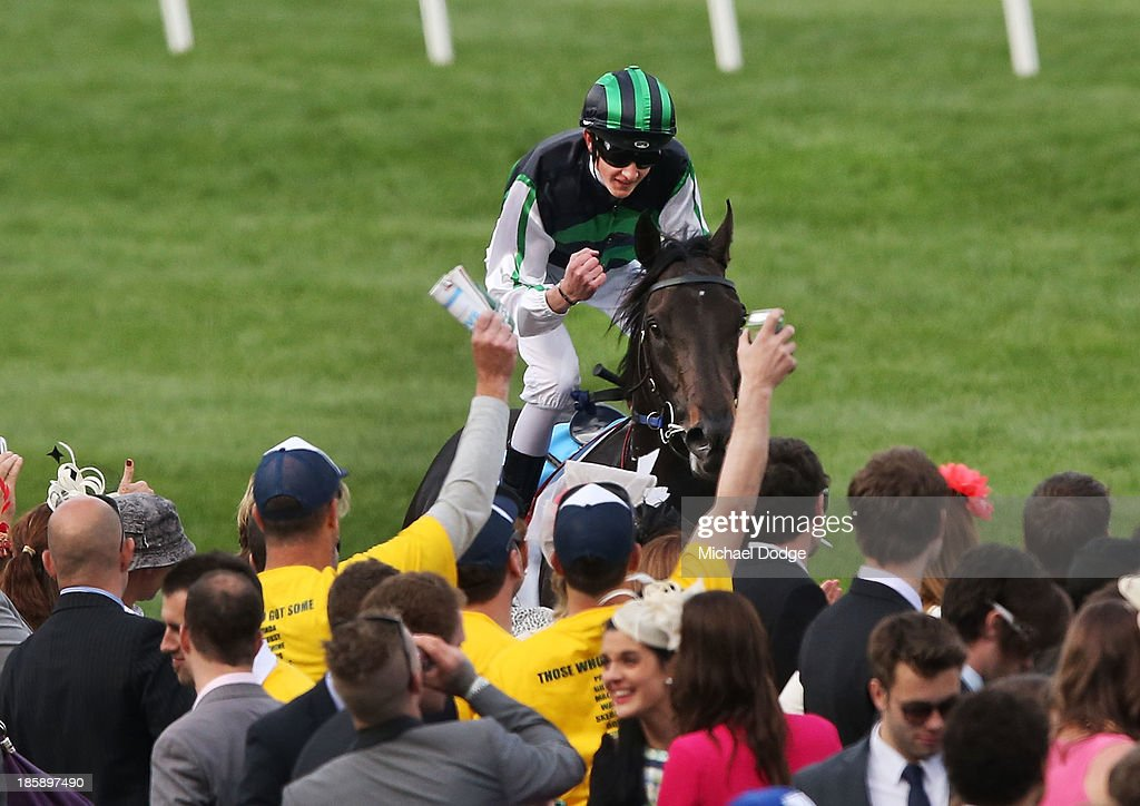 Chad Schofield riding on Shamus Award celebrates his win in race 10 the Sportingbet Cox Plate during Cox Plate Day at Moonee Valley Racecourse on October 26, 2013 in Melbourne, Australia.