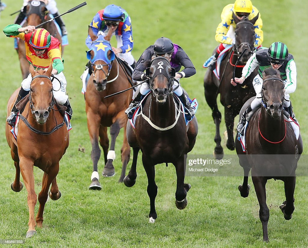 Chad Schofield (R) riding on Shamus Award defeats Dwayne Dunn (L) on Happy Trails and Blake Shin (C) on Fiorente to win race 10 the Sportingbet Cox Plate during Cox Plate Day at Moonee Valley Racecourse on October 26, 2013 in Melbourne, Australia.