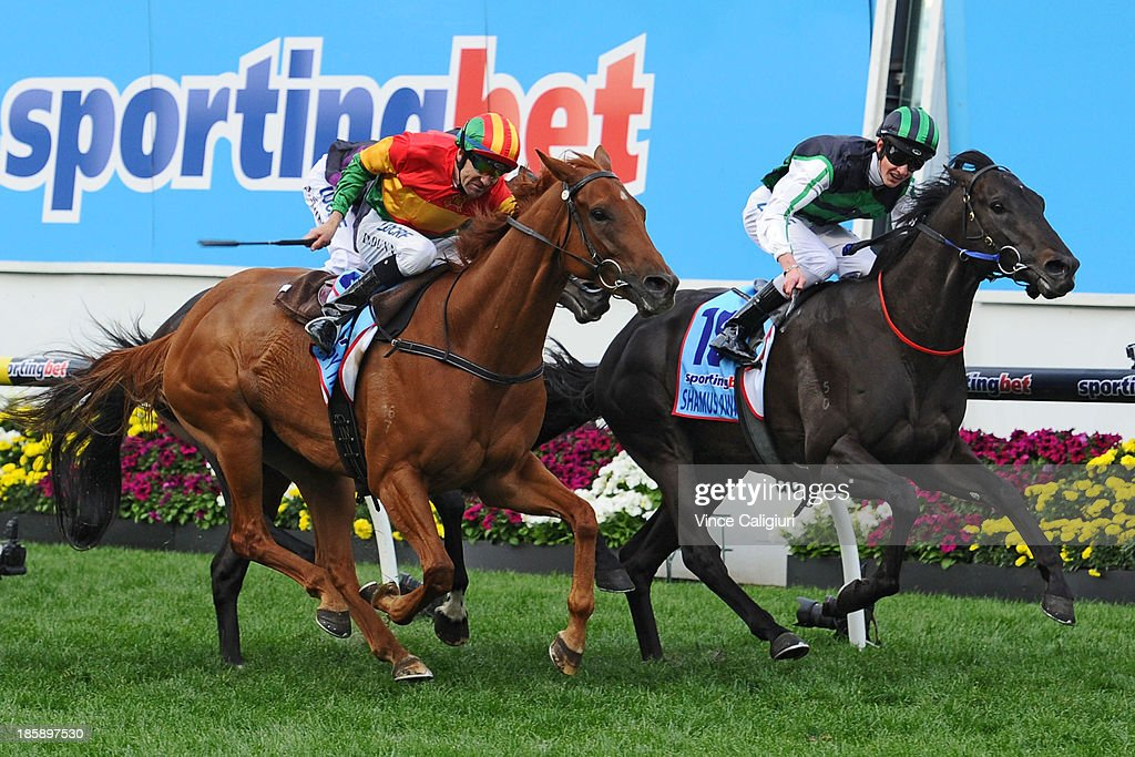 Chad Schofield riding Shamus Award defeats Dwayne Dunn riding Happy Trails in race 10 the Sportingbet Cox Plate during Cox Plate Day at Moonee Valley Racecourse on October 26, 2013 in Melbourne, Australia.