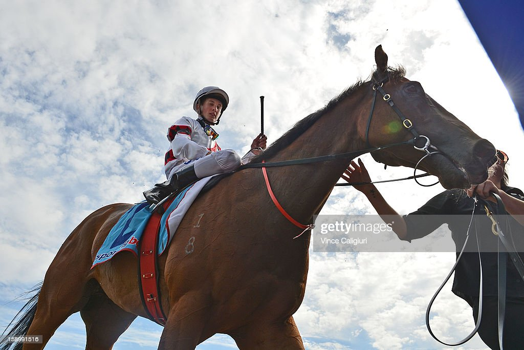 Chad Schofield riding Whisper Downs after winning the Robert Hunter Handicap during Caulfield racing at Caulfield Racecourse on January 5, 2013 in Melbourne, Australia.
