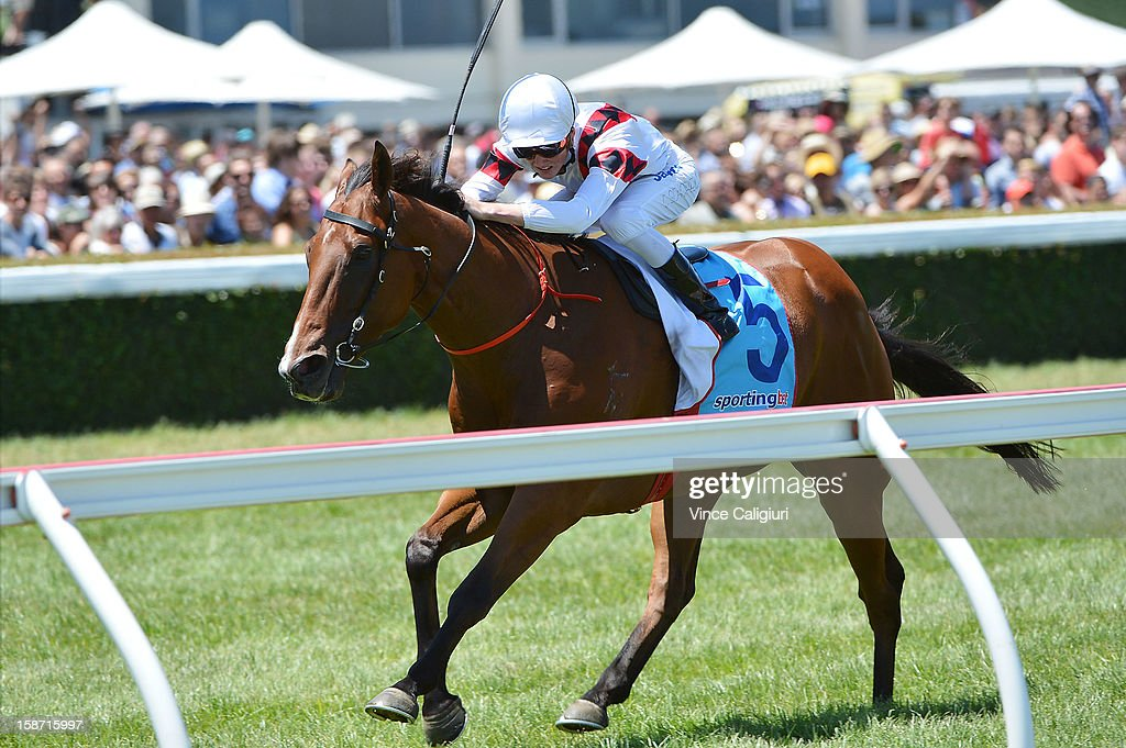 Chad Schofield riding Whisper Downs wins the Allan Wicks Handicap at Caulfield Racecourse on December 26, 2012 in Melbourne, Australia.