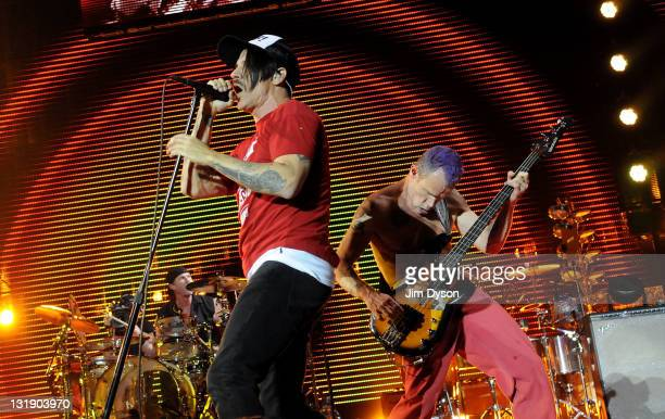 Chad Smith Anthony Kiedis and Flea of American rock band Red Hot Chili Peppers oerform live on stage at the O2 Arena on November 7 2011 in London...