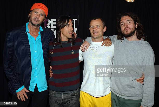 Chad Smith Anthony Kiedis Flea and John Frusciante of the Red Hot Chili Peppers signing items for auction in MTV VH1 CMT's ReAct Now Music Relief...