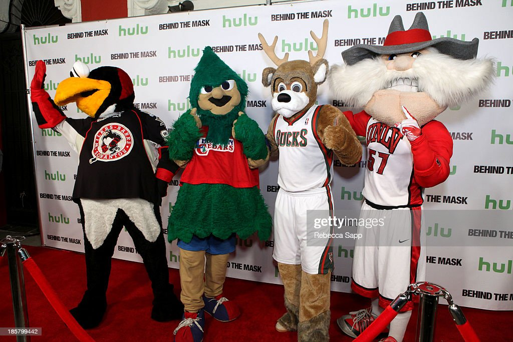 Chad Spencer as AHL hockey's Tux the Penguin, Michael Hostetter as Lebanon High School's Rooty the Cedar Tree, Kevin Vanderkolk as NBA's Milwaukee Bucks' Bango and Jon 'Jersey' Goldman as UNLV's Hey Reb at Hulu Presents The LA Premiere Of 'Behind the Mask' at the Vista Theatre on October 24, 2013 in Los Angeles, California.