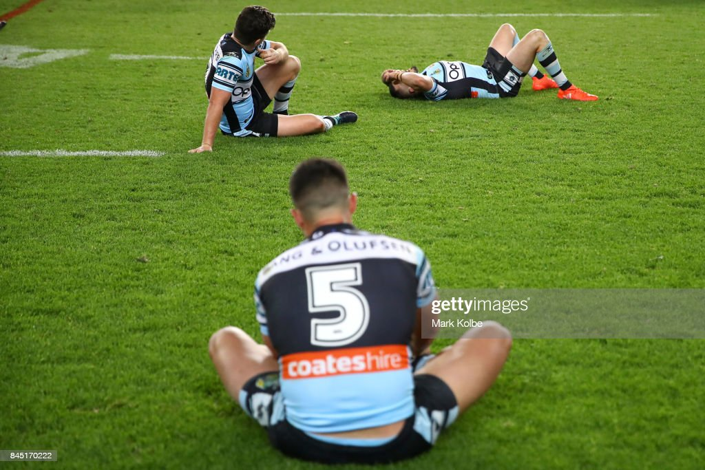 Chad Townsend, Jack Bird and Gerard Beale of the Sharks look dejected after defeat during the NRL Elimination Final match between the Cronulla Sharks and the North Queensland Cowboys at Allianz Stadium on September 10, 2017 in Sydney, Australia.