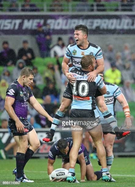 Chad Townsend of the Sharks and Matt Prior of the Sharks celebrate after James Segeyaro of the Sharks scored the matchwinning try as Billy Slater of...