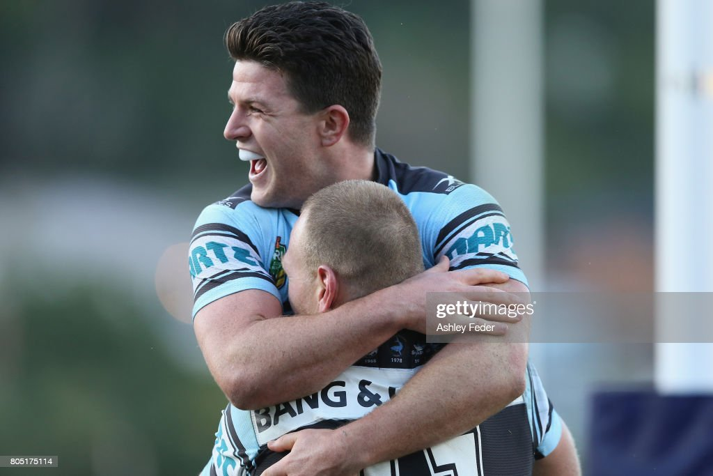 Chad Townsend of the Sharks celebrates a try from Luke Lewis of the Sharks during the round 17 NRL match between the Sydney Roosters and the Cronulla Sharks at Central Coast Stadium on July 1, 2017 in Gosford, Australia.