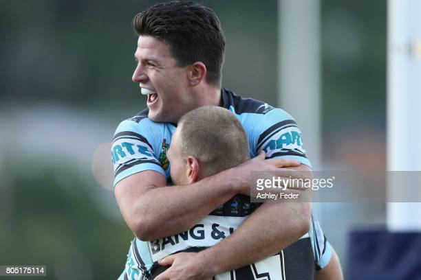 Chad Townsend of the Sharks celebrates a try from Luke Lewis of the Sharks during the round 17 NRL match between the Sydney Roosters and the Cronulla...