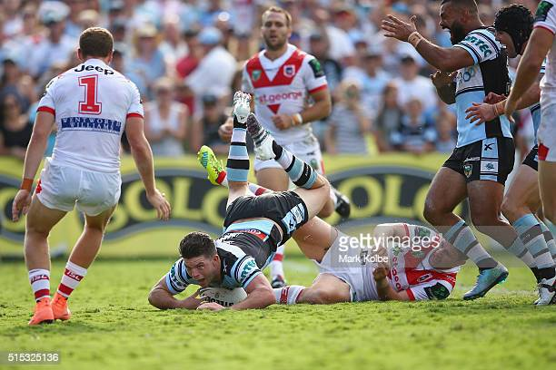 Chad Townsend of the Sharks dives over to score a try during the round two NRL match between the Cronulla Sharks and the St George Illawarra Dragons...