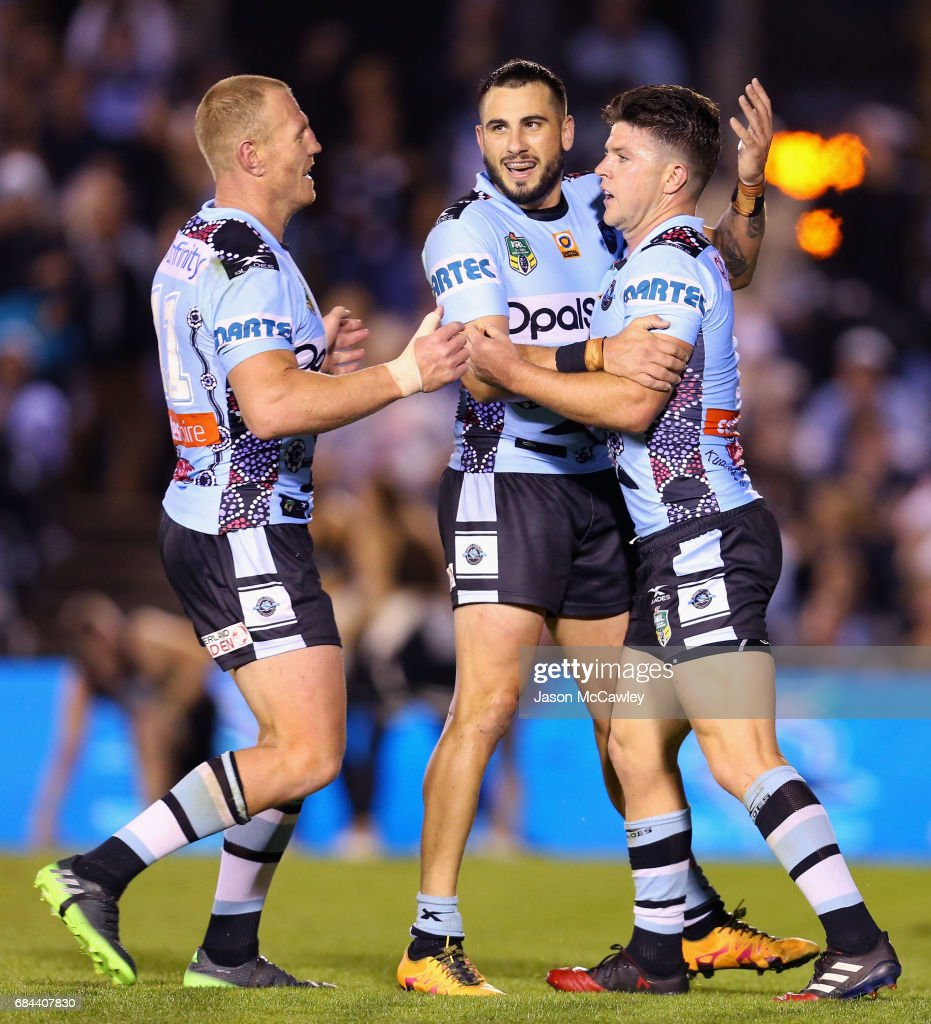 Chad Townsend of the Sharks is congratulated by Jack Bird after scoring a try during the round 11 NRL match between the Cronulla Sharks and the North Queensland Cowboys at Southern Cross Group Stadium on May 18, 2017 in Sydney, Australia.