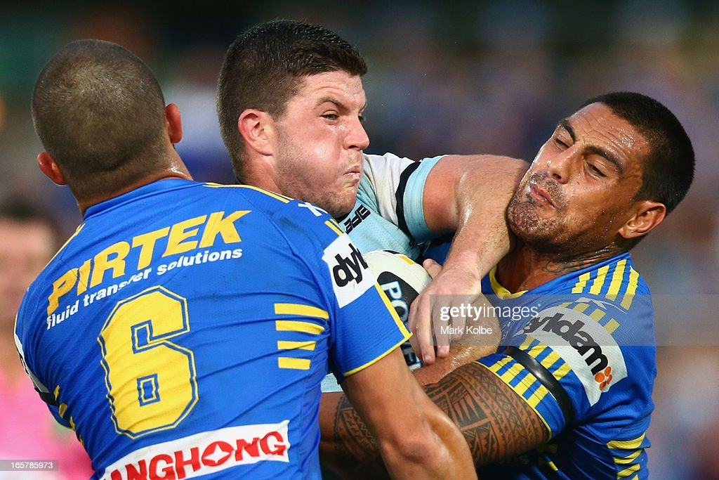 Chad Townsend of the Sharks is tackled by <a gi-track='captionPersonalityLinkClicked' href=/galleries/search?phrase=Reni+Maitua&family=editorial&specificpeople=241540 ng-click='$event.stopPropagation()'>Reni Maitua</a> of the Eels during the round five NRL match between the Parramatta Eels and the Cronulla Sharks at Parramatta Stadium on April 6, 2013 in Sydney, Australia.