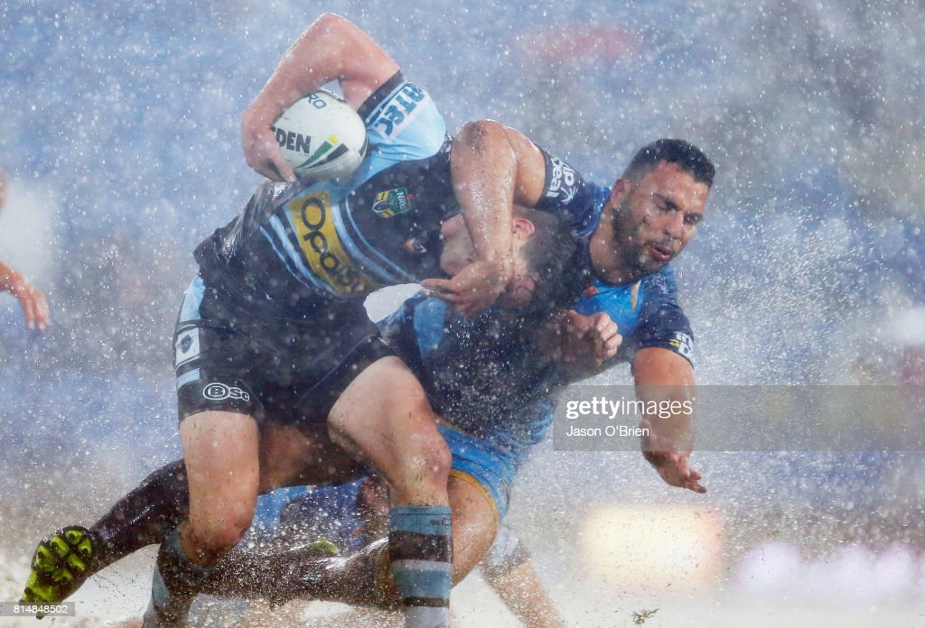 Chad Townsend of the sharks is tackled by Ryan James of the Titans during the round 19 NRL match between the Gold Coast Titans and the Cronulla Sharks at Cbus Super Stadium on July 15, 2017 in Gold Coast, Australia.
