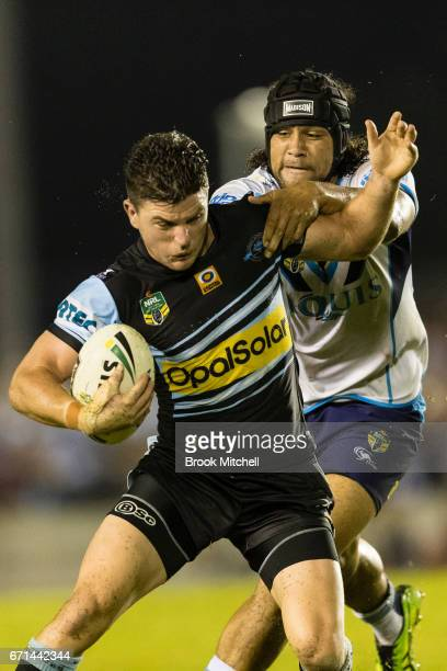 Chad Townsend of the Sharks is tackled during the round eight NRL match between the Cronulla Sharks and the Gold Coast Titans at Southern Cross Group...