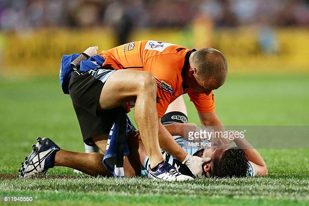 Chad Townsend of the Sharks lays on the field injured during the 2016 NRL Grand Final match between the Cronulla Sharks and the Melbourne Storm at...